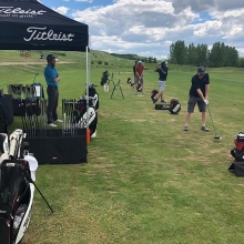 The boys R checking out the new lineup of irons at today's Demo Day. #teamtitleist #fathersday #718 #917